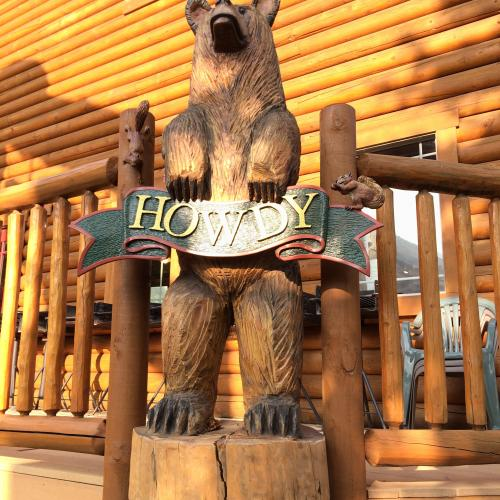 Cowboy Village bear carving